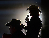 Stephanie Patterson from the office of Southern Miss Recreational Sports welcomes the crowd to the rodeo on Friday, Feb. 17, 2012. The 27th Annual Southern Miss Coca-Cola Classic Rodeo was hosted at the Forrest County Multi Purpose Center. / Bryant Hawkins for The Hattiesburg American