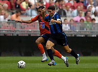 Photo: Daniel Hambury.<br />FC Porto v Inter Milan. Amsterdam Tournament. <br />05/08/2006.<br />Porto's Ezequias and Inter's Javier Zanetti battle.