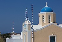 Architectural details of the church in Oia village, Santorini, Greece. Daylight view with sunlight and blue sky.