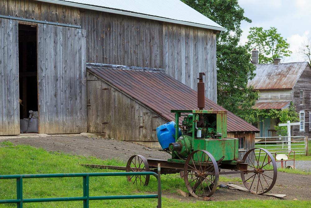 Bellville, PA, USA - May 23, 2013: A home-built farm machine with metal wheels used by an Amish farmer near Belleville in Kishacoquillas Valley, Mifflin County, PA.