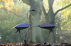 Decorative steel heron statues in autumn