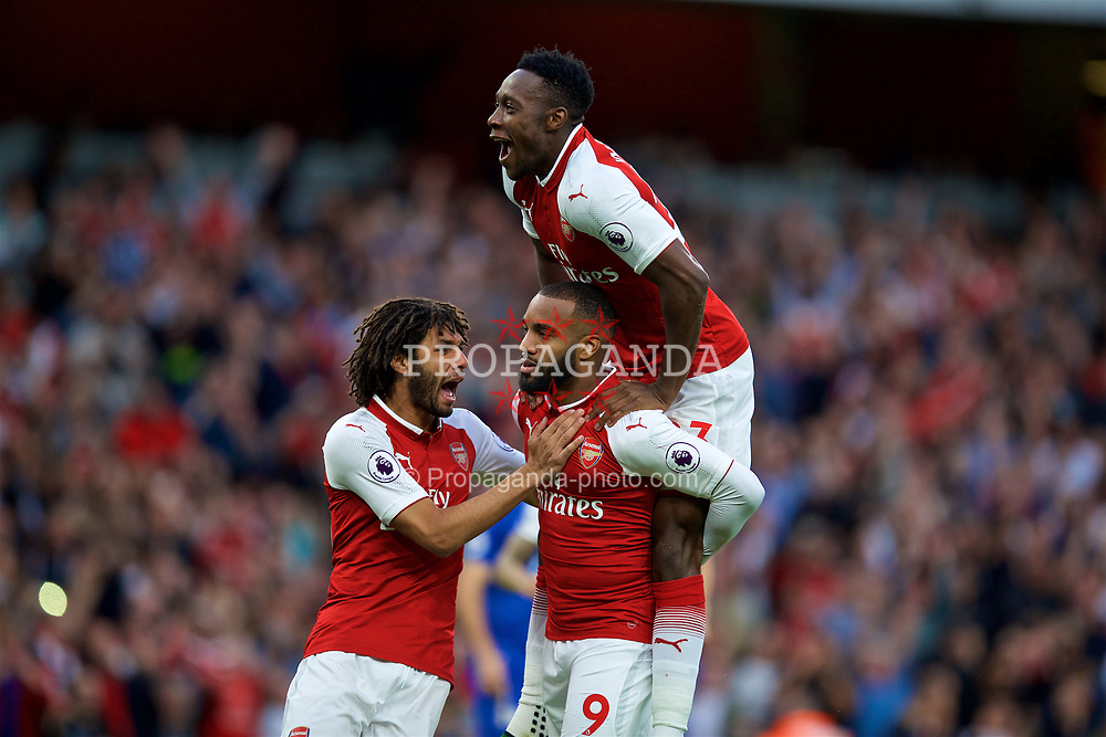 LONDON, ENGLAND - Friday, August 11, 2017: Arsenal's Alexandre Lacazette celebrates scoring the first goal with team-mates Danny Welbeck and Mohamed Elneny during the FA Premier League match between Arsenal and Leicester City at the Emirates Stadium. (Pic by David Rawcliffe/Propaganda)
