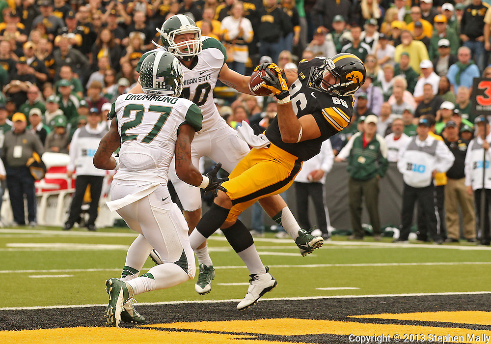 October 6 2013: Iowa Hawkeyes tight end C.J. Fiedorowicz (86) pulls in a 10 yard touchdown catch between Michigan State Spartans safety Kurtis Drummond (27) and Michigan State Spartans linebacker Max Bullough (40) during the second quarter of the NCAA football game between the Michigan State Spartans and the Iowa Hawkeyes at Kinnick Stadium in Iowa City, Iowa on October 6, 2013.