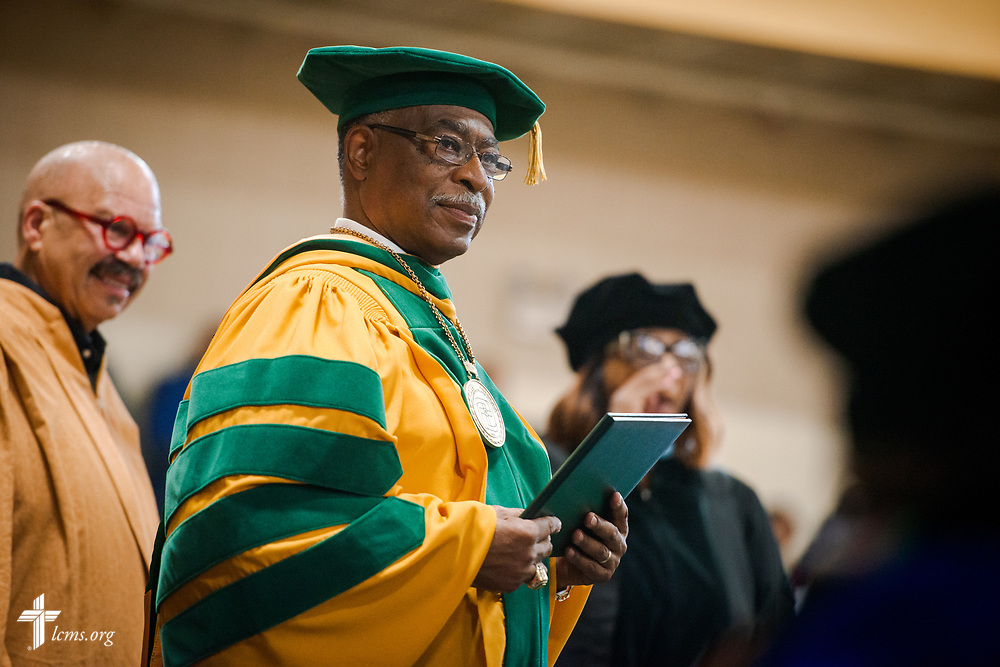 Dr. James Lyons, college transitional president, extends diplomas during the 92nd and final Commencement Exercises on Saturday, April 28, 2018, in the Julius and Mary Jenkins Center at Concordia College Alabama in Selma, Ala. LCMS Communications/Erik M. Lunsford