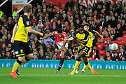 Manchester United striker Marcus Rashford (19) scores a goal to make the score 2-0 during the EFL Cup match between Manchester United and Burton Albion at Old Trafford, Manchester, England on 19 September 2017. Photo by Richard Holmes.