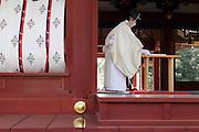 Shinto priest giving prayers during New Years celebration at the Tsurugaoka Hachimangu shrine in Kamakura