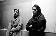 Two girls waiting to talk to their teacher of photography at the University. The majority of the Iranian students are female. Tehran, Iran, 2007