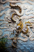 A detail of a wall with a dragon at Quan Thanh Temple in Hanoi, Vietnam.