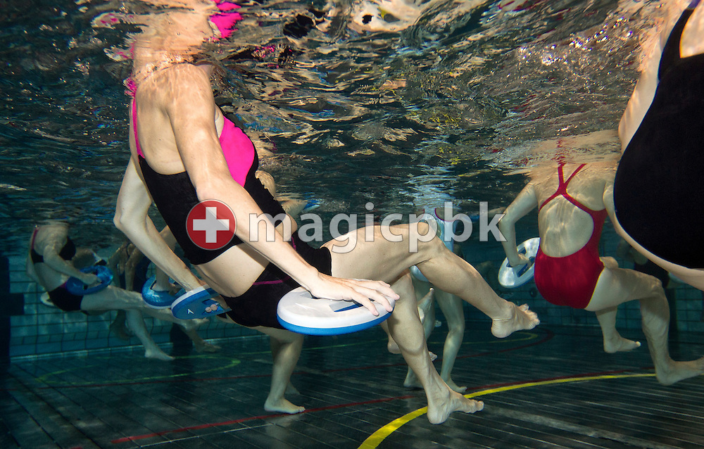 Participants take part in an Aqua Fitness lesson during the 1st Speedo Aqua-Fit Convention held in Affoltern, Switzerland, Saturday, Sept. 3, 2011. (Photo by Patrick B. Kraemer / MAGICPBK)