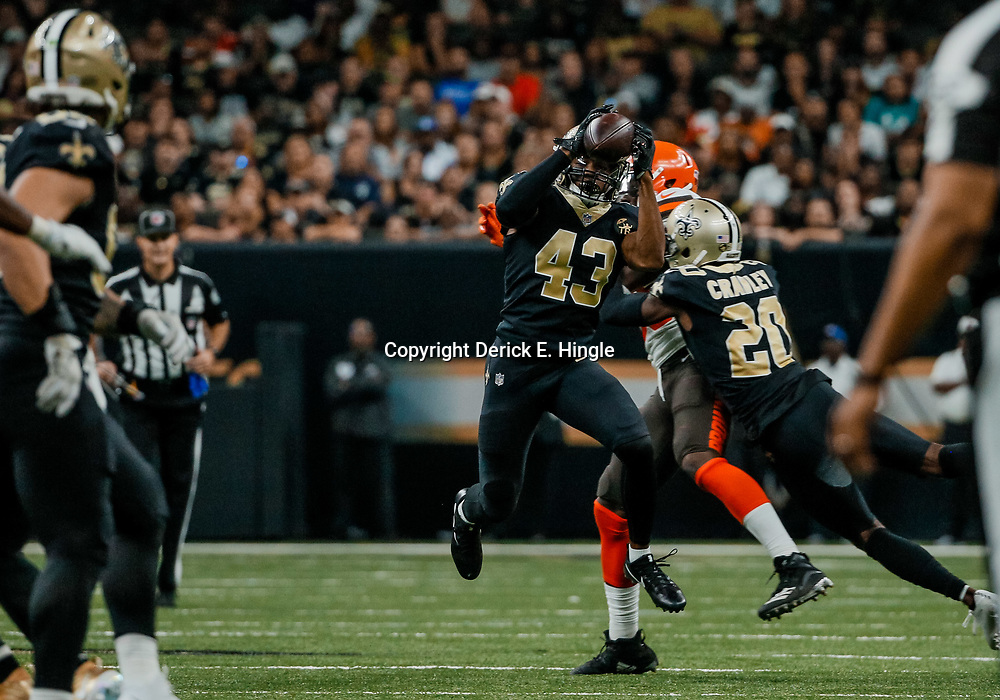 Sep 16, 2018; New Orleans, LA, USA; New Orleans Saints safety Marcus Williams (43) intercepts a pass against the Cleveland Browns during the fourth quarter of a game at the Mercedes-Benz Superdome. The Saints defeated the Browns 21-18. Mandatory Credit: Derick E. Hingle-USA TODAY Sports
