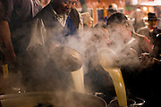 Pilgrims pour steaming butter tea at a small Buddhist monastery near the Jokhang, in Lhasa, Tibet.