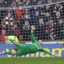Motherwell goalkeeper Trevor Carson pushes a shot from Kyle Lafferty (Hearts) just past the post during the Scottish Cup quarter final between Motherwell and Hearts at Fir Park, where the home side made it into the semi final draw with a win.<br /> <br /> (c) Dave Johnston | sportPix.org.uk