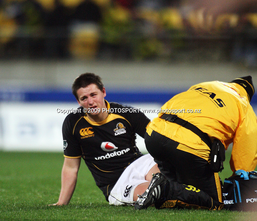 Wellington's Dane Coles goes down with an injured leg.<br /> Air NZ Cup Ranfurly Shield match - Wellington Lions v Otago at Westpac Stadium, Wellington, New Zealand. Friday, 31 July 2009. Photo: Dave Lintott/PHOTOSPORT