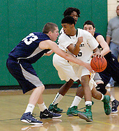 Fairmont's Joel Schiff (33) knocks the ball from Northmont junior Dominique Stollings in the third quarter as the Fairmont Firebirds play the Northmont Thunderbolts at Northmont High School in Clayton, Friday, December 16, 2011.
