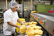 05 MAY 2008 -- PHOENIX, AZ: ELIZABETH LOPEZ packs corn tortillas at the end of the production line at La Canasta in Phoenix. La Canasta uses 20,000 - 25,000 pounds of corn daily to make almost two million tortillas. Josie Ippolito, President of La Canasta, said the price of the corn she buys has shot up more than 50 percent since November, 2007 and is expected to double by the end of this year. This in addition to the 200 percent increase in the price of wheat flour she uses in other products at La Canasta.   Photo by Jack Kurtz
