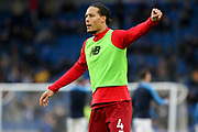 Liverpool defender Virgil van Dijk (4) warm up during the Premier League match between Brighton and Hove Albion and Liverpool at the American Express Community Stadium, Brighton and Hove, England on 12 January 2019.