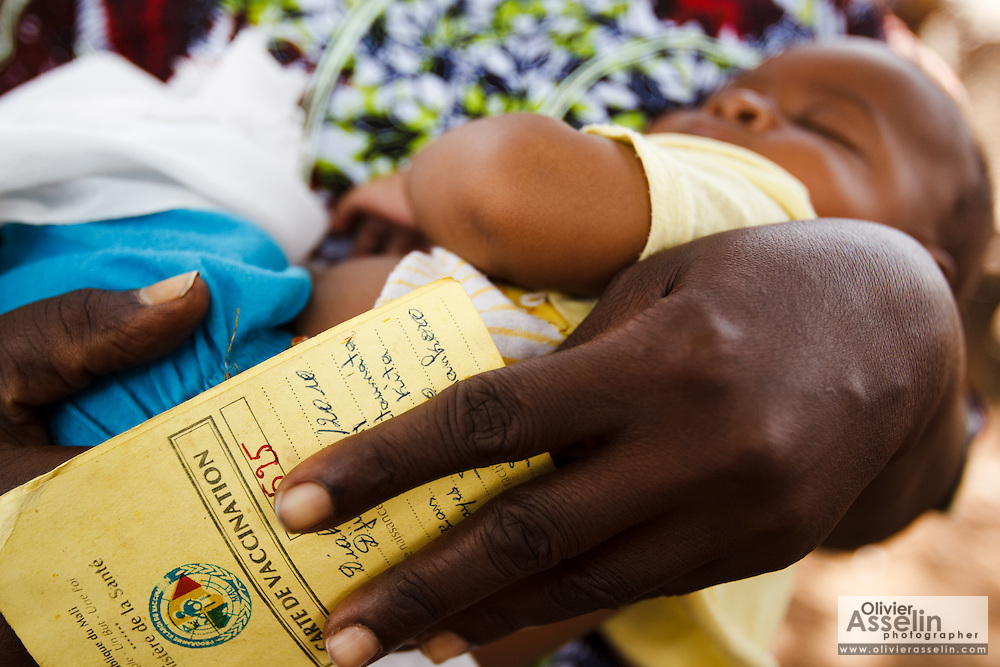 A child sleep in his mother's arms during a vaccination session in the village of Banankoro, Mali on Saturday August 28, 2010..