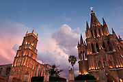 142302 MexTravel -- 03 APRIL 2004 - SAN MIGUEL DE ALLENDE, GUANAJUATO, MEXICO: Iglesia San Rafael, left, and the Parroguia, the main Catholic Church, in San Miguel de Allende, Mexico. San Miguel, which was founded in the 1600s, is one of Mexico's premier colonial cities. It has very strict zoning and building codes meant to preserve the historic nature of the city center. About 7,500 US citizens, mostly retirees, live in San Miguel. PHOTO BY JACK KURTZ