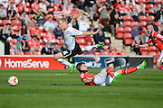 Crewe Alexandra forward Lauri Dalla Valle jumps the challenge of Walsall defender Paul Downing during the Sky Bet League 1 match between Walsall and Crewe Alexandra at the Banks's Stadium, Walsall, England on 26 September 2015. Photo by Alan Franklin.