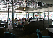 People sitting inside The Joseph Conrad Wetherspoons pub, Lowestoft, Suffolk, England