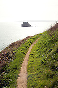 Coastal footpath to the south of the Island of Herm, Channel Islands, Great Britain - Sark in the distance