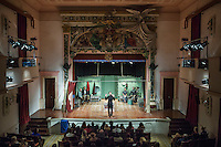 SLIEMA, MALTA - 8 FEBRUARY 2016: The touring Hamlet is performed by the Shakespeare's Globe theatre company here at the Salesian Theatre in Sliema, Malta, on February 8th 2016.<br /> <br /> The touring Hamlet, performed by the Shakespeare's Globe theatre company, is part of the Globe to Globe tour that set off in April 2014 (on the 450th anniversary of Shakespeare's birth) with the ambitious intention of visiting every country in the world over 2 years. The crew is composed of a total of sixteen men and women: four stage managers and twelve twelve actors  actors perform over two dozen parts on a stripped-down wooden stage. So far Hamlet has been performed in over 150 countries, to more than 100,000 people and travelled over 150,000 miles. The tour was granted UNESCO patronage for its engagement with local communities and its promotion of cultural education. Hamlet was also played for many dsiplaced people around the world. It was performed in the Zaatari camp on the border between Syria and Jordan, for Central African Republic refugees in Cameroon, and for Yemeni people in Djibouti. On February 3rd it was performed to about 300 refugees in Calais at the camp known as the Jungle.
