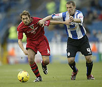 Photo: Aidan Ellis.<br /> Sheffield Wednesday v Cardiff City. Coca Cola Championship. 25/11/2006.<br /> Cardiff's Michael Chopra (R) battles with Wednesday's Kenny Lunt