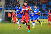 Harrison McGahey under pressure from Frank Nouble during the EFL Sky Bet League 1 match between Gillingham and Rochdale at the MEMS Priestfield Stadium, Gillingham, England on 26 November 2016. Photo by Daniel Youngs.