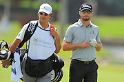 Kyle Stanley and his caddie during the first round of the World Golf Championship Cadillac Championship on the TPC Blue Monster Course at Doral Golf Resort And Spa on March 8, 2012 in Doral, Fla. ..©2012 Scott A. Miller.