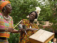 Mary Sosu and Abou Sylla perform traditional Ghanian music with the Akwaaba Ensemble during Laconia's Multicultural Festival Saturday in Rotary Park.  (Karen Bobotas/for the Laconia Daily Sun)