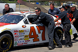 STOCKTON, CA - MAY 4: Justin Philpott, driver of the #47 MSI Development/Philpott's Garage Toyota, pushes his car to inspection during practice for the NASCAR K&N Pro Series West G-Oil 150 at the Stockton 99 Speedway on May 4, 2013 in Stockton, California. (Photo by Jason O. Watson/Getty Images for NASCAR) *** Local Caption *** Justin Philpott