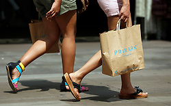 Embargoed to 0001 Friday July 7 File photo dated 16/07/13 of shoppers in central London as the UK high street has enjoyed its best June in six years after the warm weather lured shoppers out to overhaul their wardrobes.