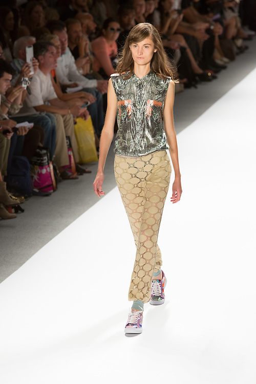 Eyelet lace white pants and print sleeveless top. By Custo Barcelona at the Spring 2013 Fashion Week show in New York.