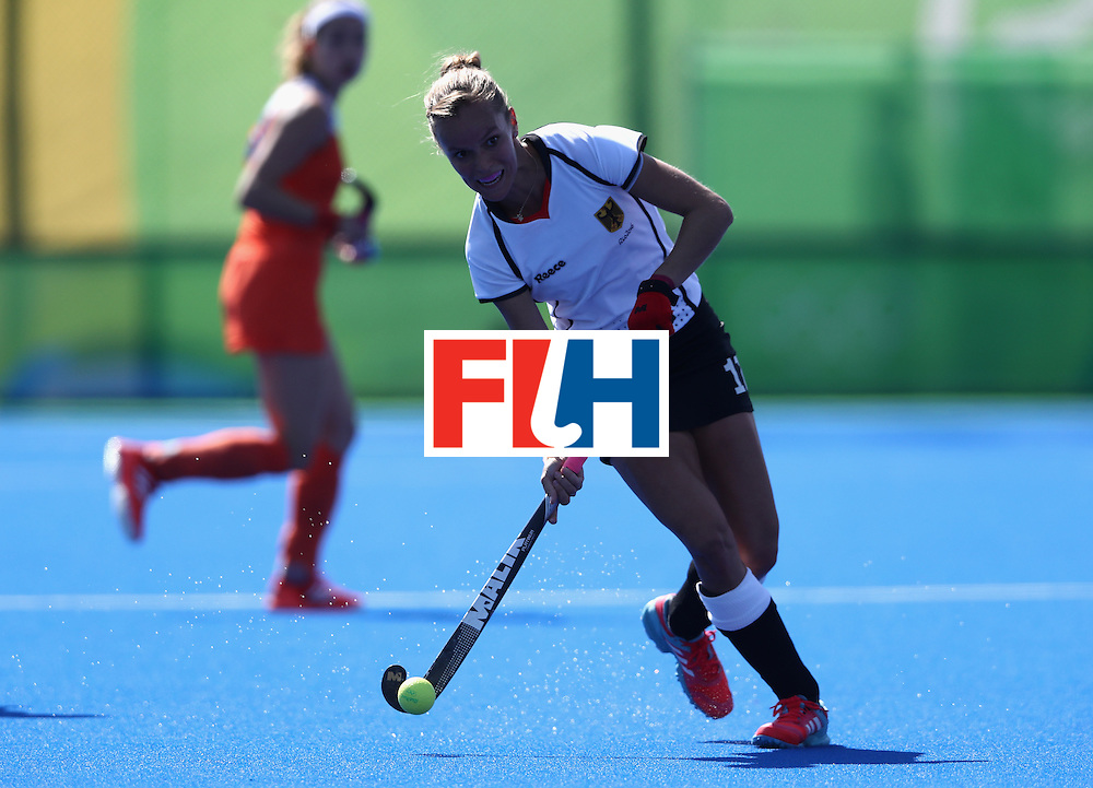 RIO DE JANEIRO, BRAZIL - AUGUST 13:  Jana Teschke of Germany runs with the ball during the Women's group A hockey match between the Netherlands and Germany on Day 8 of the Rio 2016 Olympic Games at the Olympic Hockey Centre on August 13, 2016 in Rio de Janeiro, Brazil.  (Photo by David Rogers/Getty Images)
