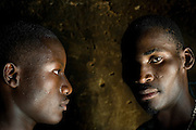 Men with scarifications on their face in Natitingou, Benin February 25, 2008. Scarification is used as a form of initiation into adulthood, beauty and a sign of a village, tribe, and clan.