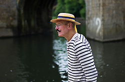 © Licensed to London News Pictures.13/06/15<br /> Durham, England<br /> <br /> A man in period costume watches the racing during the 182nd Durham Regatta rowing event held on the River Wear. The origins of the regatta date back  to commemorations marking victory at the Battle of Waterloo in 1815. This is the second oldest event of this type in the country and attracts over 2000 competitors from across the country.<br /> <br /> Photo credit : Ian Forsyth/LNP