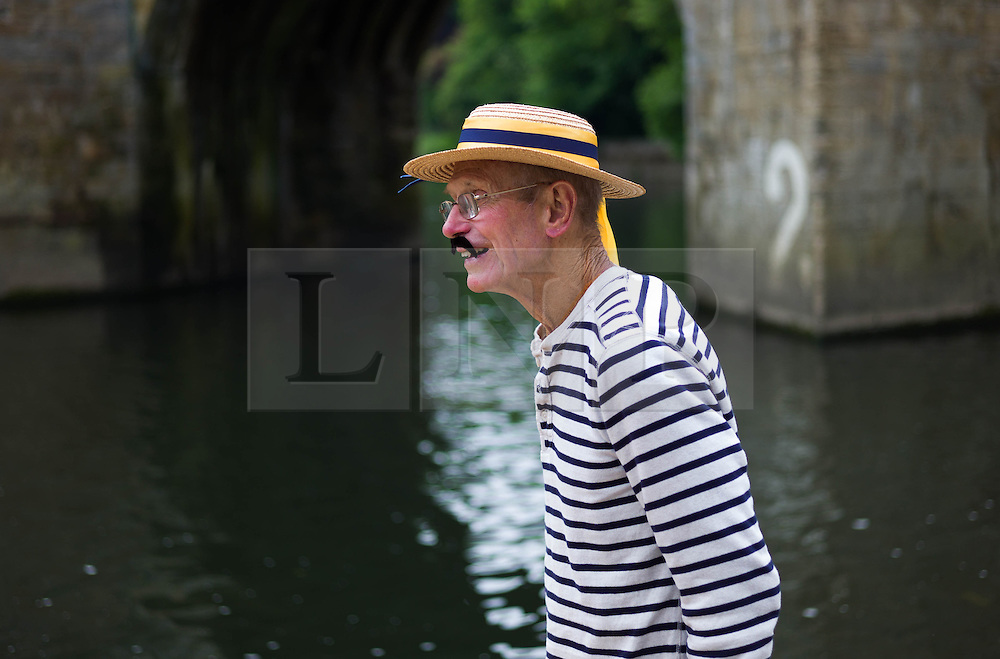 &copy; Licensed to London News Pictures.13/06/15<br /> Durham, England<br /> <br /> A man in period costume watches the racing during the 182nd Durham Regatta rowing event held on the River Wear. The origins of the regatta date back  to commemorations marking victory at the Battle of Waterloo in 1815. This is the second oldest event of this type in the country and attracts over 2000 competitors from across the country.<br /> <br /> Photo credit : Ian Forsyth/LNP