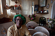 Michel Legris, sega musician and Master Ravanne (a goat skin drum) maker at his home.