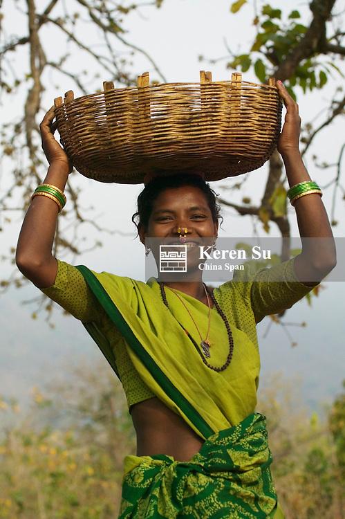 Woman carrying basket on head, Orissa, India