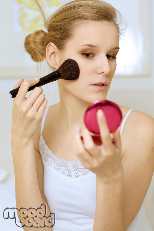 A woman applying make-up