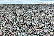 Pebbles make a splash of colour on Bossington Beach, Somerset, UK