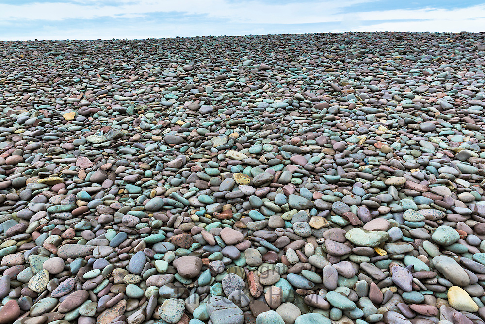 Pebbles make a splash of colour on Bossington Beach, Somerset, UK