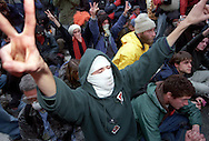 "During the World Trade Organization meeting in Seattle in 1999, tens of thousands gathered to protest, effectively shutting down the WTO talks as delegates were unable to get to the convention center. Peaceful protests devolved into a riot now known as ""the Battle in Seattle"" as Seattle Police employed batons, tear gas, pepper spray, non-lethal projectiles and concussion grenades to hold protesters at bay. Support from neighboring agencies was called and the National Guard was deployed as Mayor Paul Schell declared a civil emergency, downtown no-protest zone, and curfew."