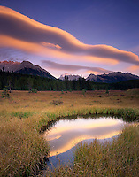 Evening clouds reflected in pond, Kananaskis Country Alberta Canada