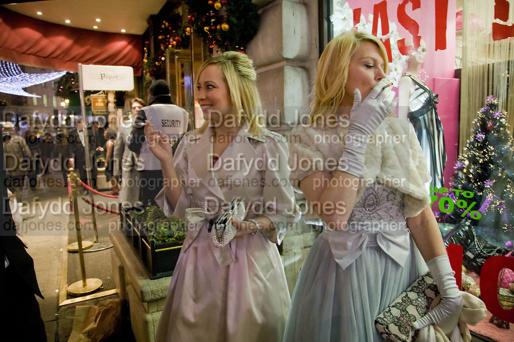 Laura Turner; Sandra Boxall. Having a cigarette before going in to the Cafe Royal Regent St. closure party. The party in aid of the Spingboard Charity Trust. The hotel is being re-developed and will close at the end of this week. 16 December 2008