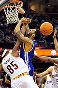 March 8, 2011; Cleveland, OH, USA; Cleveland Cavaliers point guard Baron Davis (85) blocks Golden State Warriors point guard Acie Law (2) during the fourth quarter at Quicken Loans Arena. The Warriors beat the Cavaliers 95-85. Mandatory Credit: Jason Miller-US PRESSWIRE