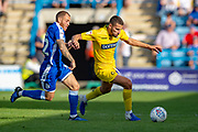Gillingham FC defender Barry Fuller (12) and Wycombe Wanderers midfielder Nick Freeman (22)  during the EFL Sky Bet League 1 match between Gillingham and Wycombe Wanderers at the MEMS Priestfield Stadium, Gillingham, England on 14 September 2019.