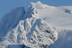 The slopes of Mount Wrather tower above the Mendenhall Glacier. The Mendenhall Glacier runs roughly 12 miles, originating in the Juneau Icefield, near Juneau, Alaska. The glacier is located 12 miles from downtown Juneau.