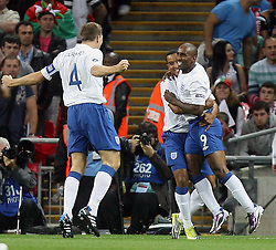 04.09.2010, Wembley Stadium, London, ENG, UEFA Euro 2012 Qualification, England v Bulgaria, im Bild Jermain Defoe of England makes 1-0 and celebrates with Steve Gerrard of England and Glen Johnson of England. EXPA Pictures © 2010, PhotoCredit: EXPA/ IPS/ Marcello Pozzetti +++++ ATTENTION - OUT OF ENGLAND/UK +++++ / SPORTIDA PHOTO AGENCY