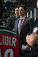 KELOWNA, CANADA - NOVEMBER 5: Travis Crickard, goalie coach of the Kelowna Rockets, stands on the bench against the Victoria Royals on November 5, 2014 at Prospera Place in Kelowna, British Columbia, Canada.  (Photo by Marissa Baecker/Shoot the Breeze)  *** Local Caption *** Travis Crickard;